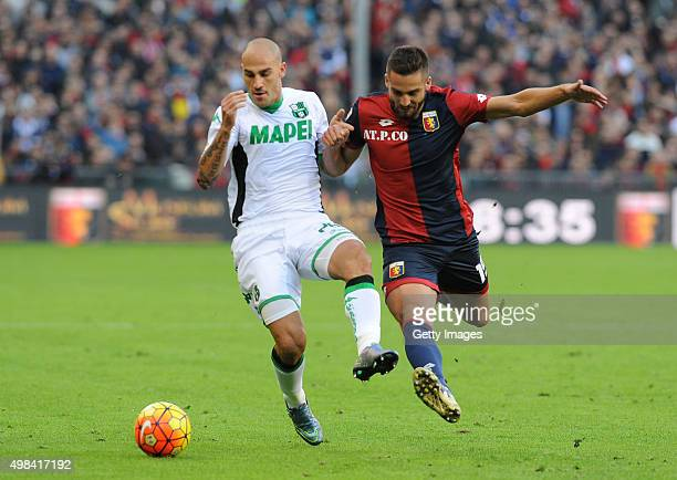 Paolo Cannavaro of US Sassuolo Calcio battles for the ball with Leonardo Pavoletti of Genoa CFC during the Serie A match between Genoa CFC and US...