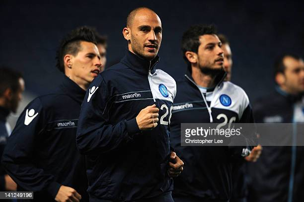Paolo Cannavaro runsj with his teammates during a Napoli training session ahead of the UEFA Champions League round of sixteen second leg match...