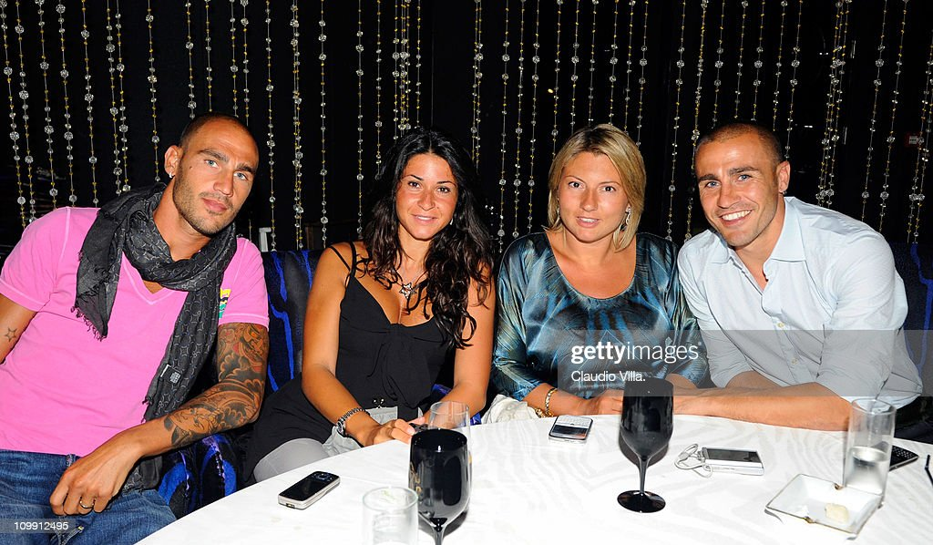 <a gi-track='captionPersonalityLinkClicked' href=/galleries/search?phrase=Paolo+Cannavaro&family=editorial&specificpeople=728856 ng-click='$event.stopPropagation()'>Paolo Cannavaro</a> with his wife Cristina Martino and <a gi-track='captionPersonalityLinkClicked' href=/galleries/search?phrase=Fabio+Cannavaro&family=editorial&specificpeople=204335 ng-click='$event.stopPropagation()'>Fabio Cannavaro</a> with his wife Daniela Arenoso on August 15, 2010 in Dubai, United Arab Emirates.