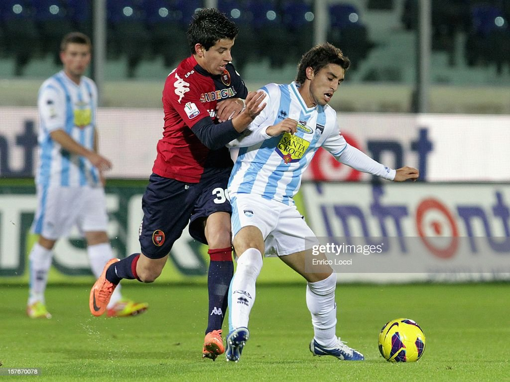 Paolo Ceppelini of Cagliari competes for the ball with Juan Fernando Quintero (R) of Pescara during the TIM Cup match between Cagliari Calcio and Pescara at Stadio Is Arenas on December 5, 2012 in Cagliari, Italy.