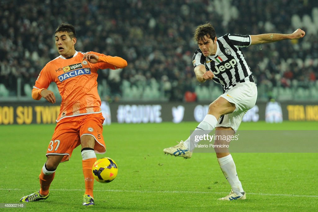 Paolo De Ceglie (R) of Juventus kicks the ball during the Serie A match between Juventus and Udinese Calcio at Juventus Arena on December 1, 2013 in Turin, Italy.