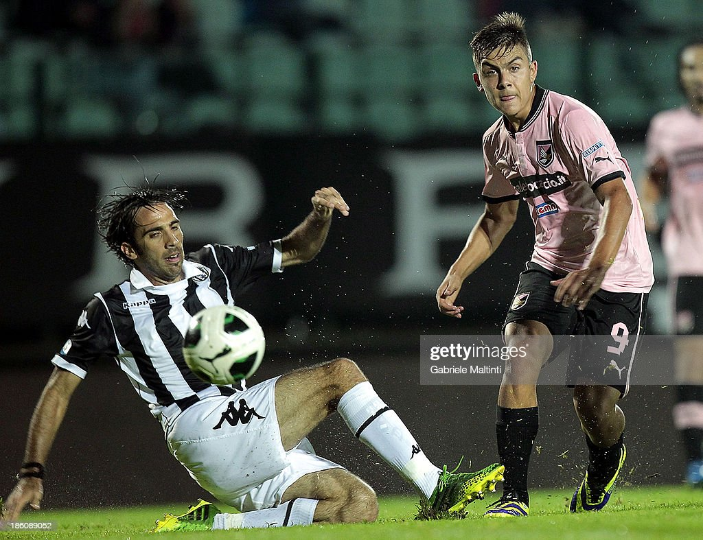 Paolo Dellafiore (L) of AC Siena fights for the ball with Paulo Dybala of US Citta' di Palermo during the Serie B match between AC Siena and US Citta di Palermo at Artemio Franchi - Mps Arena on October 21, 2013 in Siena, Italy.