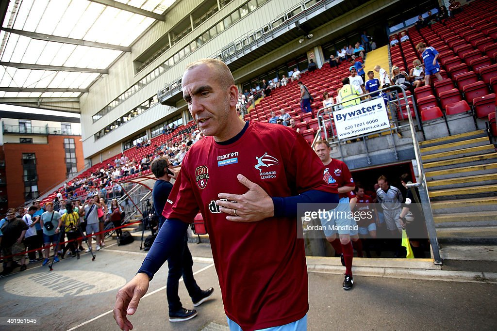 Paolo Di Canio leads out the 'Hammers Heroes' during the Football30 Elite Legends Tournament at Brisbane Road on May 18 2014 in London England