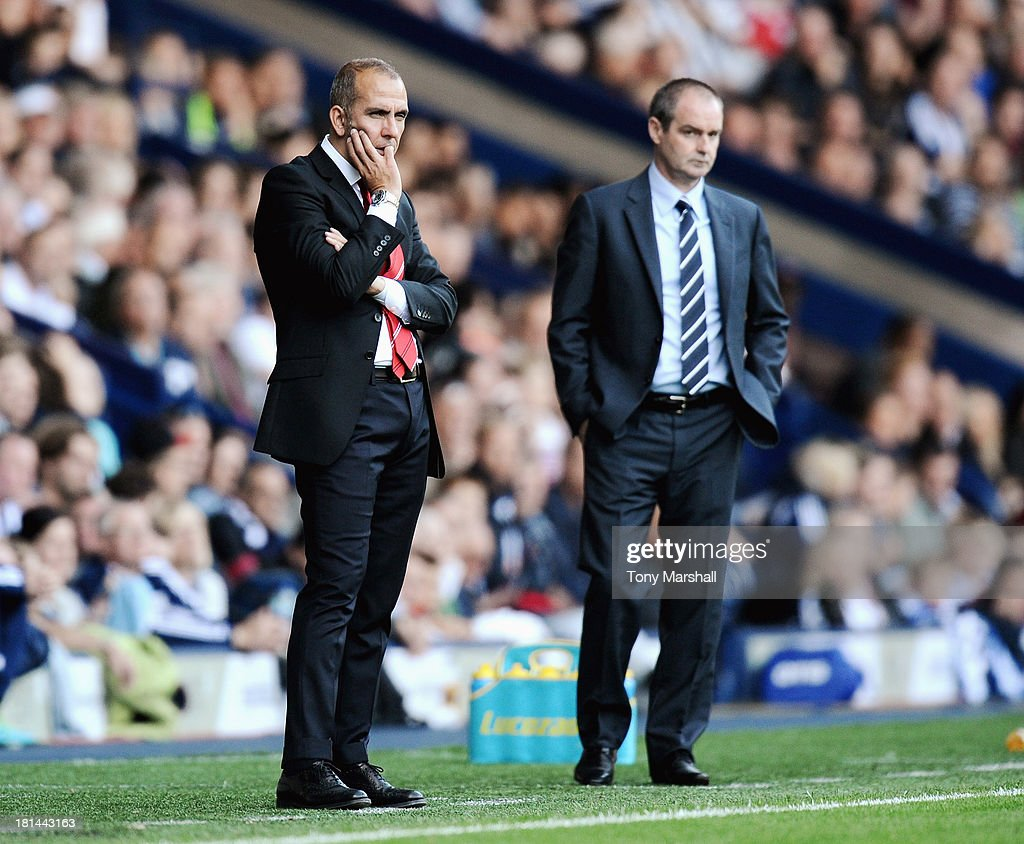 Paolo Di Canio, manager of Sunderland and Steve Clark, manager of West Bromwich Albion on the touch line during the Barclays Premier League match between West Bromwich Albion and Sunderland at The Hawthorns on September 21, 2013 in West Bromwich, England.