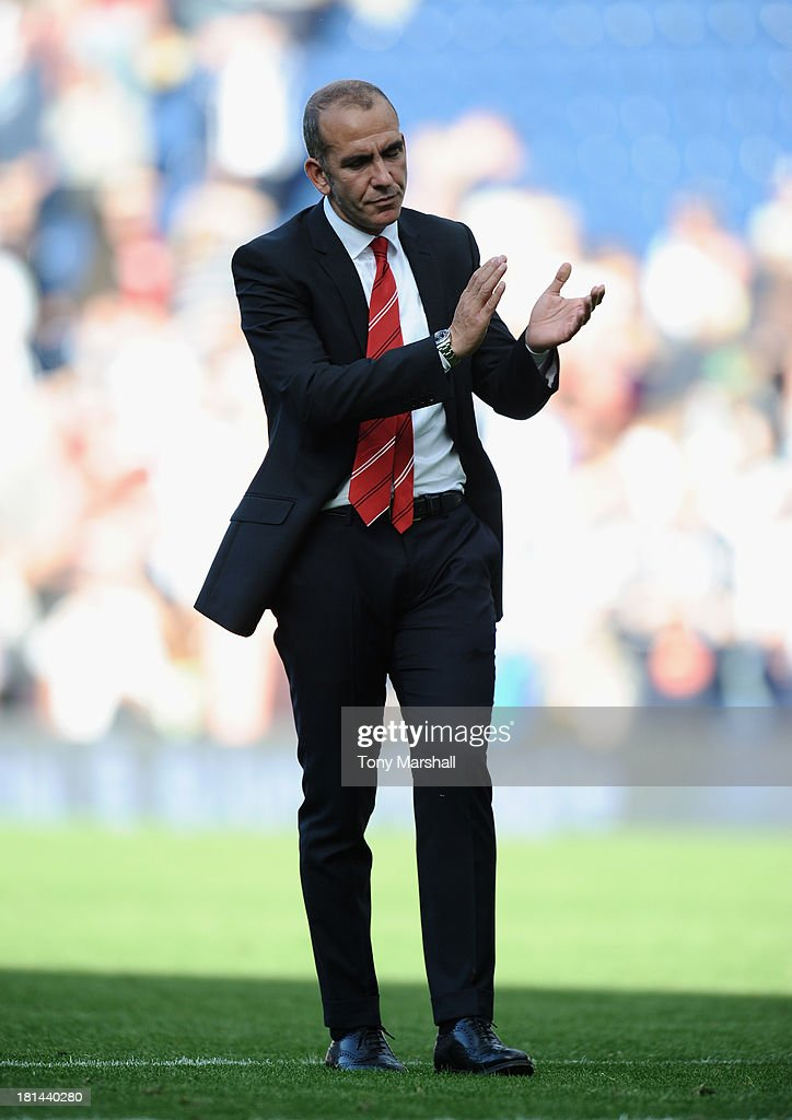 <a gi-track='captionPersonalityLinkClicked' href=/galleries/search?phrase=Paolo+Di+Canio&family=editorial&specificpeople=215237 ng-click='$event.stopPropagation()'>Paolo Di Canio</a>, manager of Sunderland appluads the fans at the end of the Barclays Premier League match between West Bromwich Albion and Sunderland at The Hawthorns on September 21, 2013 in West Bromwich, England.