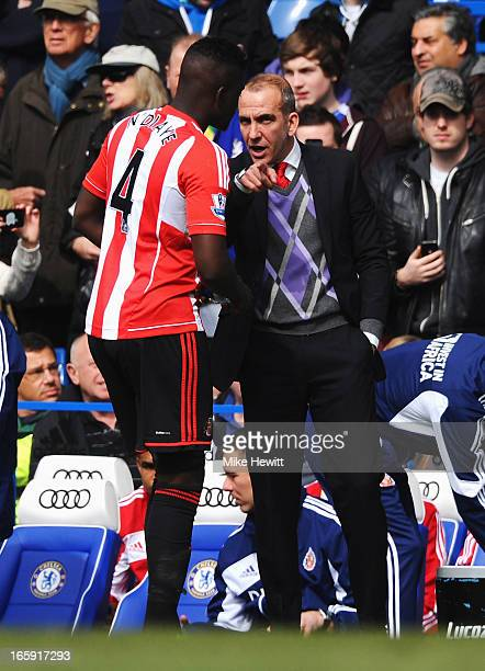 Paolo Di Canio manager of Sunderland talks to Alfred N'Diaye of Sunderland prior to the Barclays Premier League match between Chelsea and Sunderland...