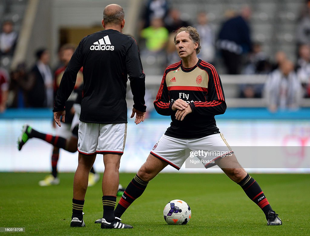 Paolo Di Canio of AC Milan Glorie is seen chatting to Franco Baresi (R) ahead of the Steve Harper testimonial match between Newcastle United and AC Milan Glorie at St James' Park on September 11, 2013 in Newcastle upon Tyne, England.