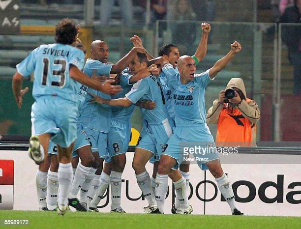 Paolo di Canio of Lazio and other Lazio players celebrate the goal by Tommaso Rocchi during the Serie A football match between Roma and Lazio at the...