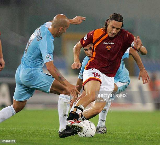 Paolo di Canio of Lazio challenges Francesco Totti of Romaduring the Serie A football match between Roma and Lazio at the Olympic stadium on October...
