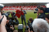 Paolo di Canio poses for photographers during a press conference to announce his arrival as manager of Swindon Town FC at County Ground on May 23...