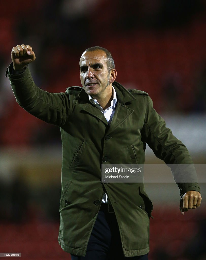 Paolo Di Canio the manager of Swindon Town acknowledges the crowd after his sides 31 victory during the Capital One Cup Third Round match between...