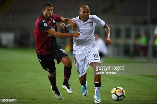 Paolo Farago of Cagliari Calcio competes with Haitam Aleesami of US Citta di Palermo during the TIM Cup match between Cagliari Calcio and US Citta di...