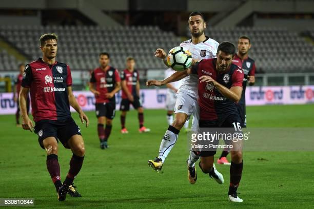 Paolo Farago of Cagliari Calcio competes with Ilja Nestorovski of US Citta di Palermo during the TIM Cup match between Cagliari Calcio and US Citta...