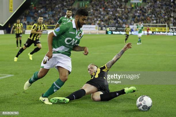 Paolo Fernandes of NAC Breda Alexander Buttner of Vitesse during the Dutch Eredivisie match between Vitesse Arnhem and NAC Breda at Gelredome on...