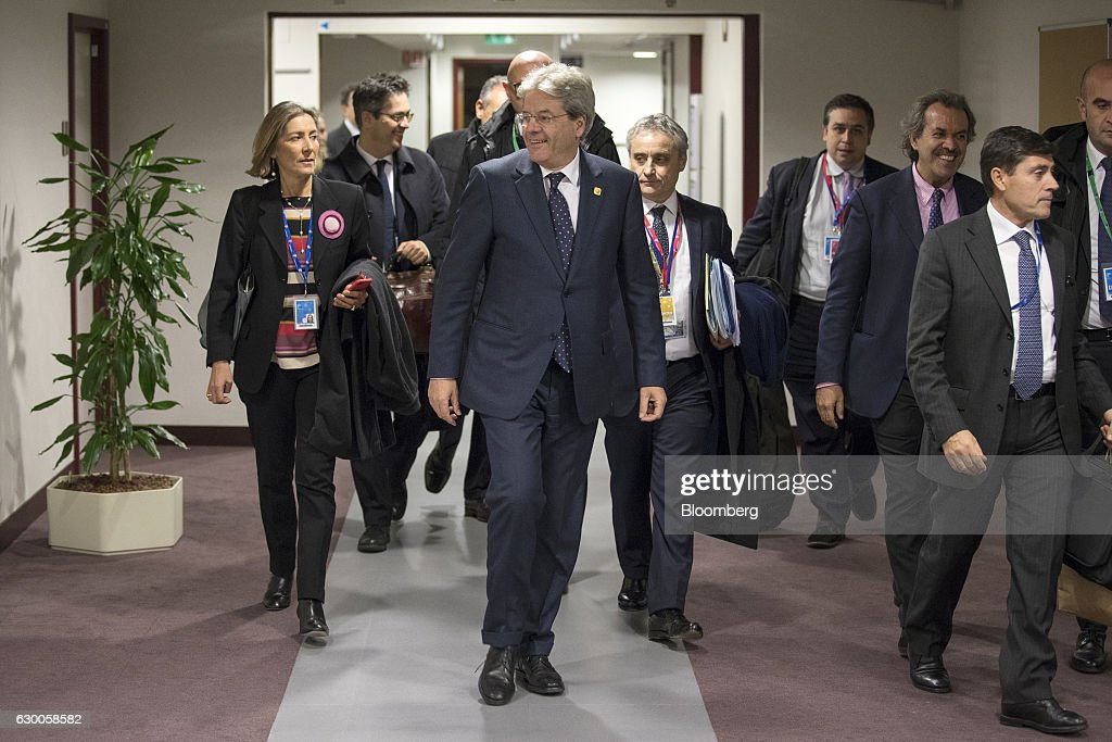 Paolo Gentiloni, Italy's prime minister, center, arrives for a news conference after a meeting of European Union (EU) leaders in Brussels, Belgium, on Thursday, Dec. 15, 2016. A first glimpse of the European Union's potential for disunity on Brexit emerged at the Brussels summit, as EU leaders were caught up in a dispute over how the bloc negotiates with the U.K. as it heads for the door. Photographer: Jasper Juinen/Bloomberg via Getty Images