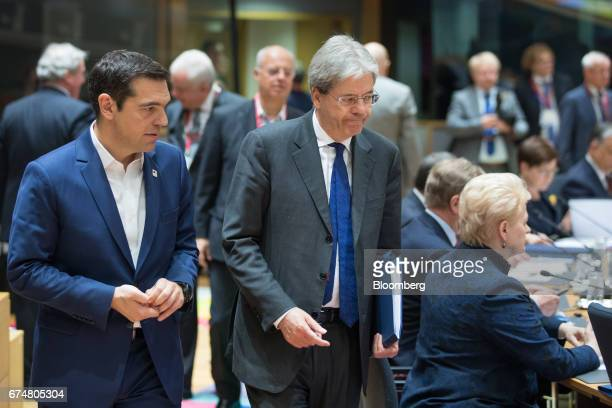 Paolo Gentiloni Italy's prime minister center walks with Alexis Tsipras Greece's prime minister left prior to a round table meeting during a European...