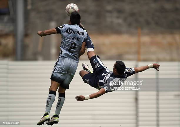 Paolo Goltz of America vies for the ball with Rogelio Funes of Monterrey during their Mexican Clausura 2016 tournament football match at the Azteca...