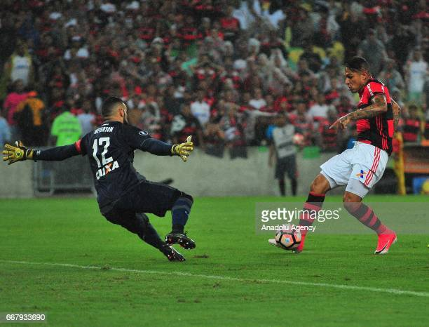 Paolo Guerreiro of Flamengo in action against Weverton of Atletico Paranaense during a match between Flamengo and Atletico Paranaense as part of Copa...