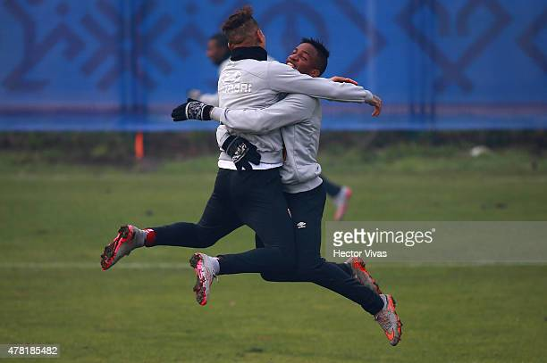 Paolo Guerrero and Jefferson Farfan of Peru celebrate during a training session at German Becker Stadium on June 23 2015 in Temuco Chile Peru will...