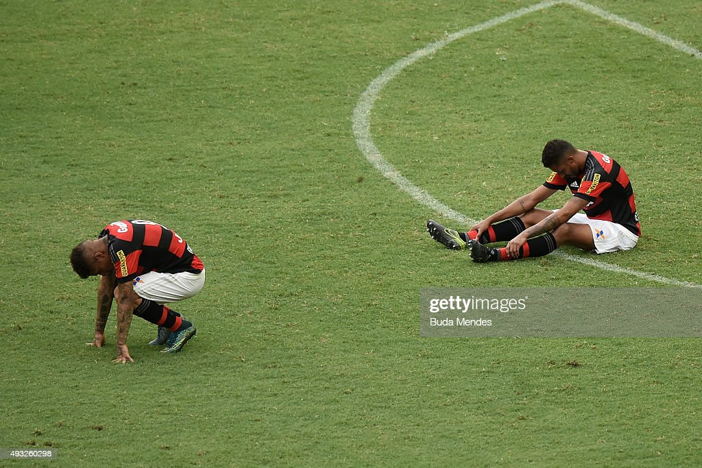 Paolo Guerrero (L) and Kayke of Flamengo react tol a lost match between Flamengo and Internacional as part of Brasileirao Series A 2015 at Maracana Stadium on October 18, 2015 in Rio de Janeiro, Brazil.