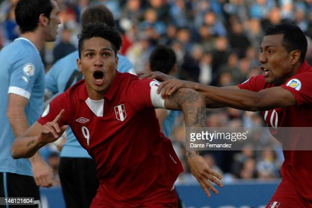 Paolo Guerrero from Peru celebrates a goal during a match between Uruguay and Peru as part of the sith round of the South American Qualifiers for...