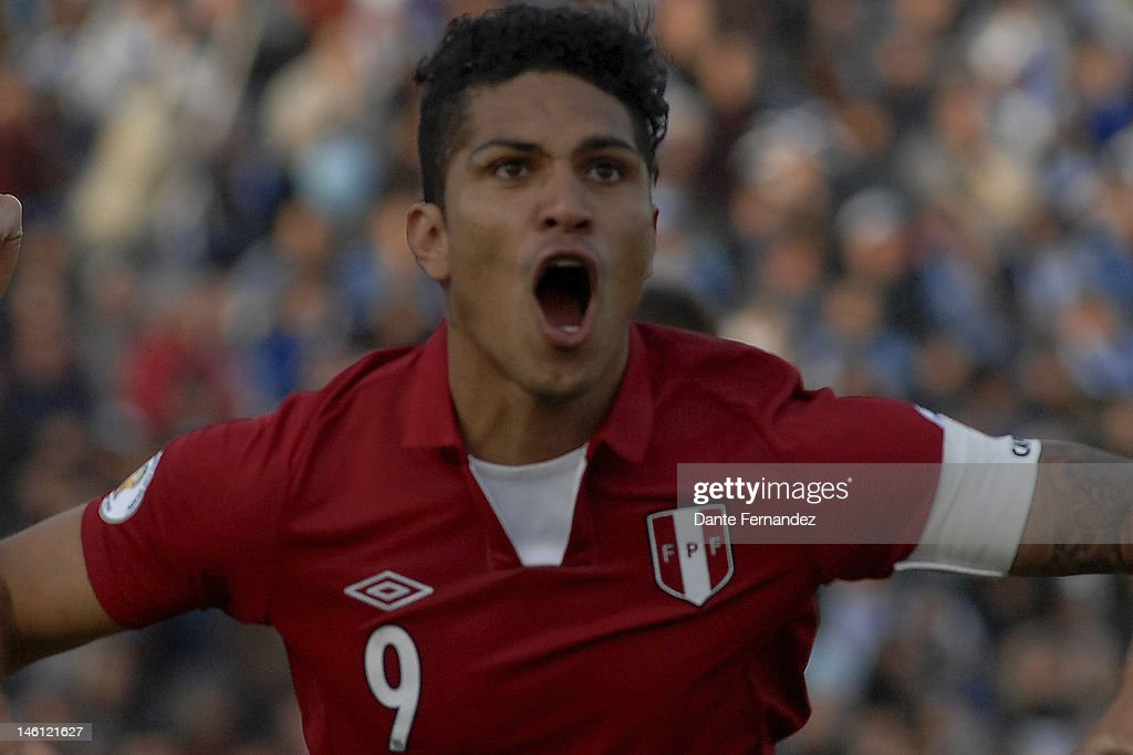 Paolo Guerrero from Peru celebrates a scored goal during a match between Uruguay and Peru as part of the sith round of the South American Qualifiers for FIFA World Cup Brazil 2014 at Estadio Centenatio on June 10,2012 in Montevideo,Uruguay.