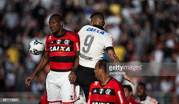 Paolo Guerrero of Corinthians and Samir Caetano of Flamengo during the Brasileirao Series A 2014 match between Corinthians and Flamengo at Pacaembu...