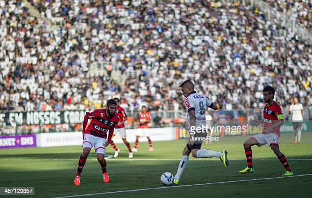 Paolo Guerrero of Corinthians and Wallace Silva and Leonardo Moura of Flamengo during the Brasileirao Series A 2014 match between Corinthians and...
