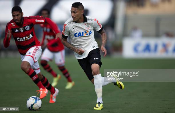 Paolo Guerrero of Corinthians and Wallace Silva of Flamento during the Brasileirao Series A 2014 match between Corinthians and Flamengo at Pacaembu...
