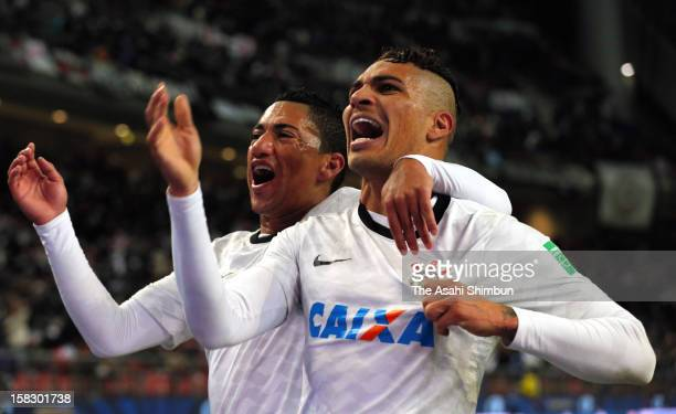Paolo Guerrero of Corinthians celebrates his opening goal with his teammate Ralf during the FIFA Club World Cup Semi Final match between AlAhly SC...