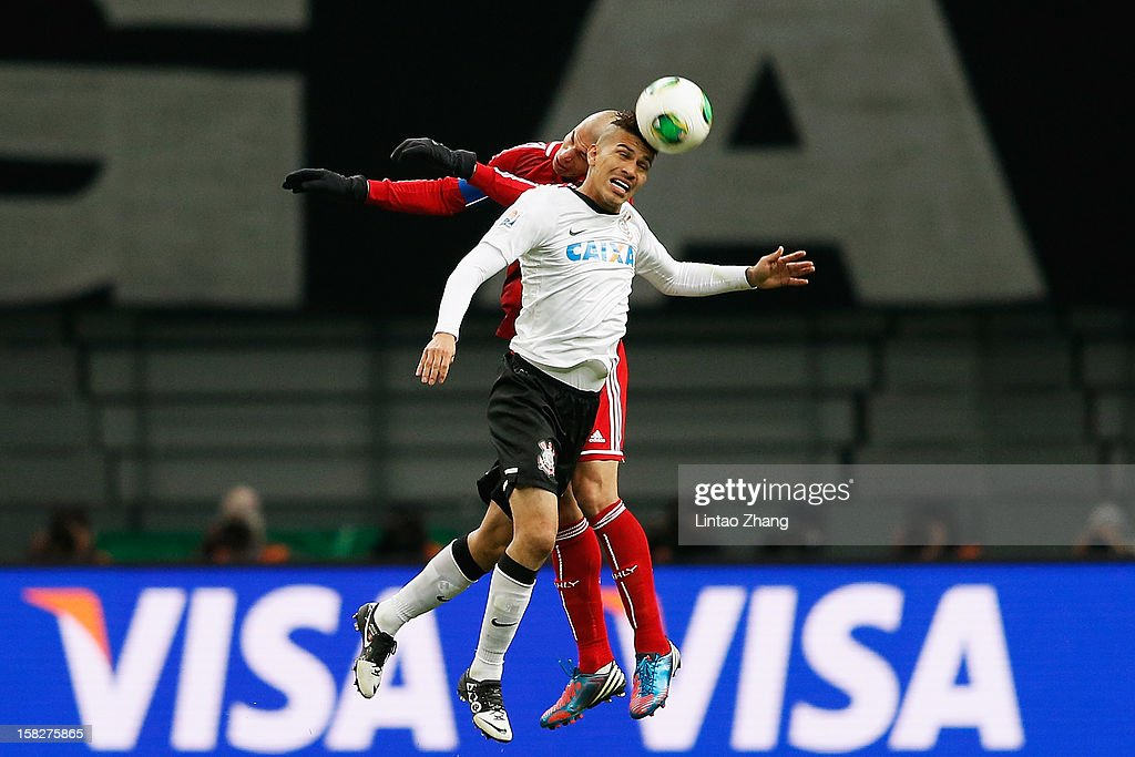 Paolo Guerrero (Front) of Corinthians competes for an aerial ball with Wael Gomaa of Al-Ahly SC during the FIFA Club World Cup Semi Final match between Al-Ahly SC and Corinthians at Toyota Stadium on December 12, 2012 in Toyota, Japan.