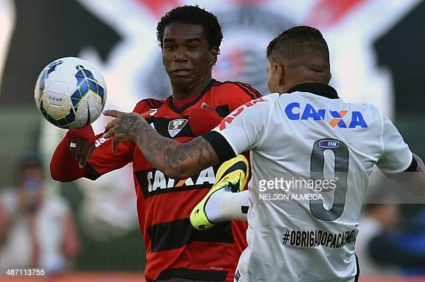 Paolo Guerrero of Corinthians vies for the ball with Luis Antonio of Flamengo during their Brazilian championship football match at Pacaembu stadium...