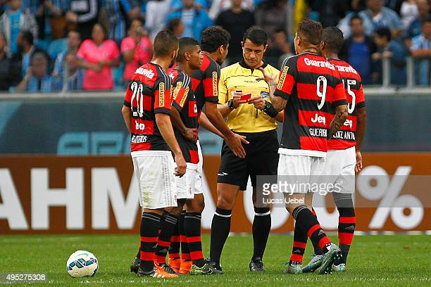 Paolo Guerrero of Flamengo argues with the referee after he receives red card during the match Gremio v Flamengo as part of Brasileirao Series A 2015...