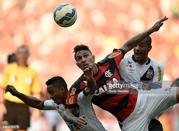 Paolo Guerrero of Flamengo battles for the ball with Jorge Henrique and Rodrigo of Vasco during a match between Flamengo and Vasco as part of...