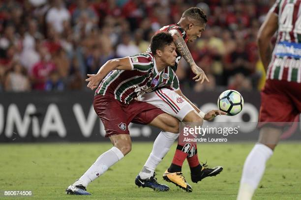 Paolo Guerrero of Flamengo battles for the ball with Reginaldo of Fluminense during the match between Flamengo and Fluminense as part of Brasileirao...