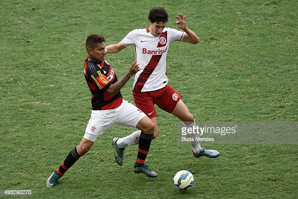 Paolo Guerrero of Flamengo battles for the ball with Rodrigo Dourado of Internacional during a match between Flamengo and Internacional as part of...