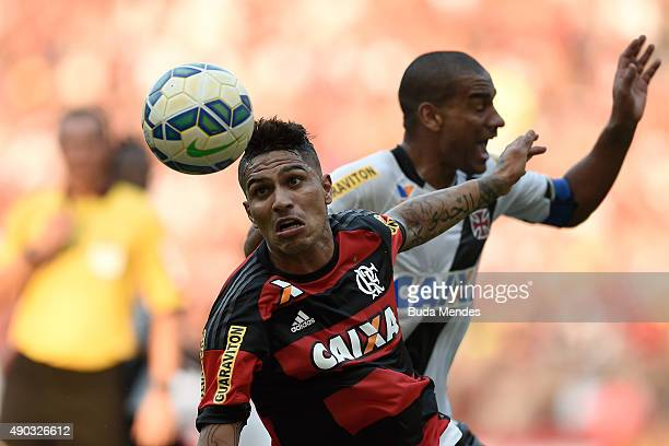 Paolo Guerrero of Flamengo battles for the ball with Rodrigo of Vasco during a match between Flamengo and Vasco as part of Brasileirao Series A 2015...