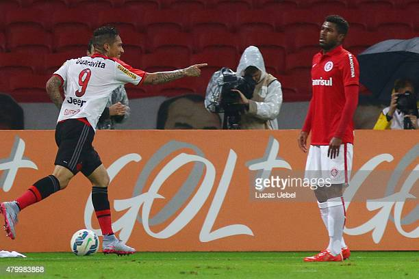 Paolo Guerrero of Flamengo celebrates their first goal during the match between Internacional and Flamengo as part of Brasileirao Series A 2015 at...