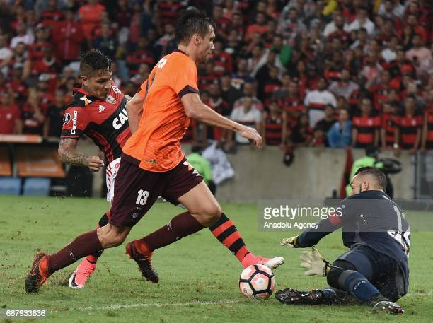 Paolo Guerrero of Flamengo in action against Paulo Andre of Atletico Paranaense during a match between Flamengo and Atletico Paranaense as part of...