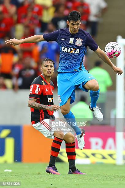 Paolo Guerrero of Flamengo struggles for the ball with Balbuena of Corinthians during a match between Flamengo and Corinthians as part of Brasileirao...