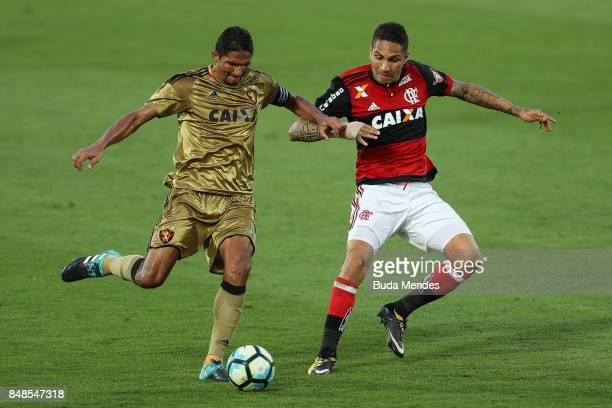 Paolo Guerrero of Flamengo struggles for the ball with Durval of Sport Recife during a match between Flamengo and Sport Recife as part of Brasileirao...