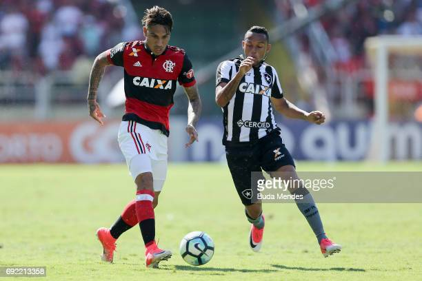 Paolo Guerrero of Flamengo struggles for the ball with Gilson of Botafogo during a match between Flamengo and Botafogo as part of Brasileirao Series...