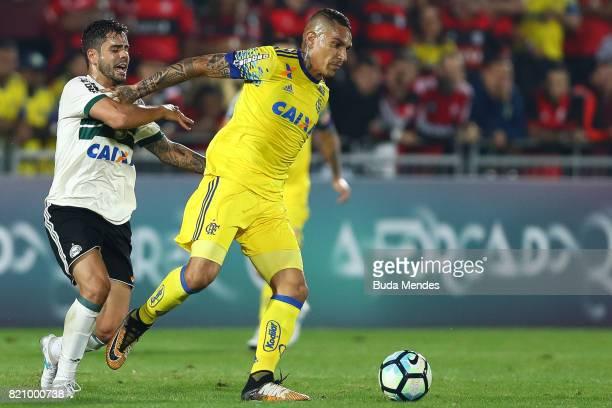 Paolo Guerrero of Flamengo struggles for the ball with Henrique Almeida of Coritiba during a match between Flamengo and Coritiba as part of...