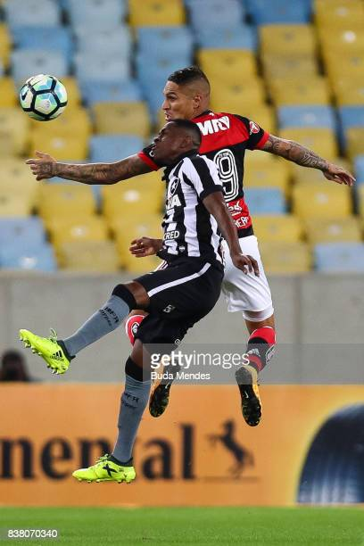 Paolo Guerrero of Flamengo struggles for the ball with Marcelo Conceio of Botafogo during a match between Flamengo and Botafogo part of Copa do...