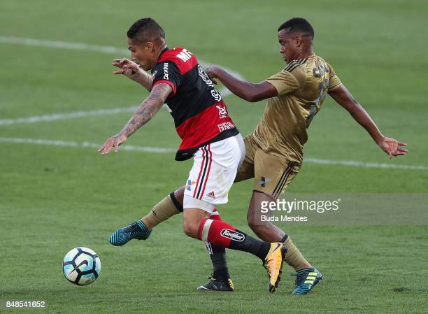 Paolo Guerrero of Flamengo struggles for the ball with Rithely of Sport Recife during a match between Flamengo and Sport Recife as part of...