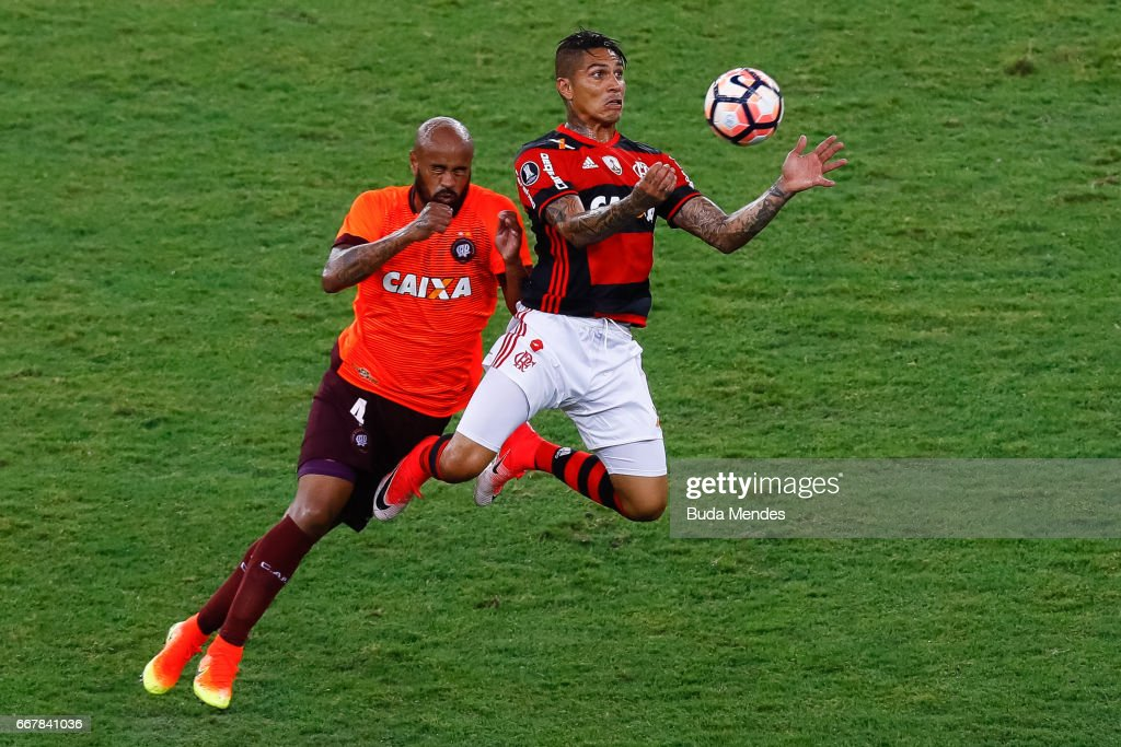 http://media.gettyimages.com/photos/paolo-guerrero-of-flamengo-struggles-for-the-ball-with-thiago-heleno-picture-id667841036