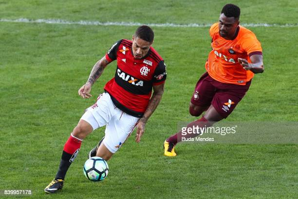 Paolo Guerrero of Flamengo struggles for the ball with Wanderson of Atletico PR during a match between Flamengo and Atletico PR as part of...