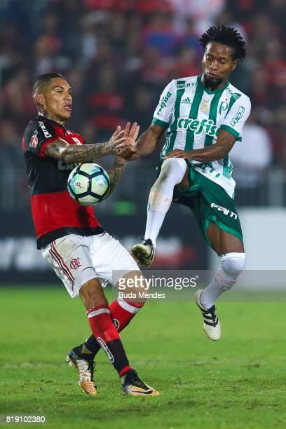 Paolo Guerrero of Flamengo struggles for the ball with Ze Roberto of Palmeiras during a match between Flamengo and Palmeiras as part of Brasileirao...
