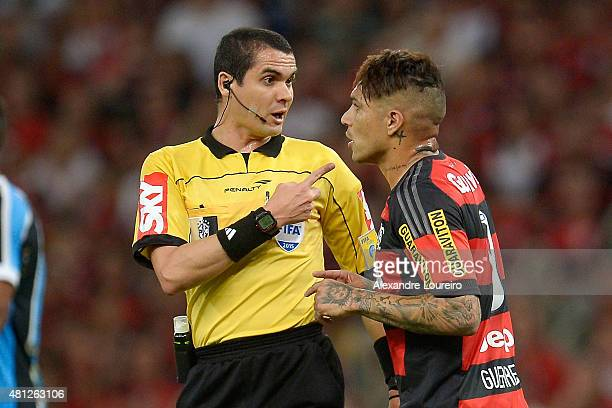 Paolo Guerrero Êof Flamengo talks with referee Mrcio Eustaquio Santiago during the match between Flamengo and Gremio as part of Brasileirao Series A...