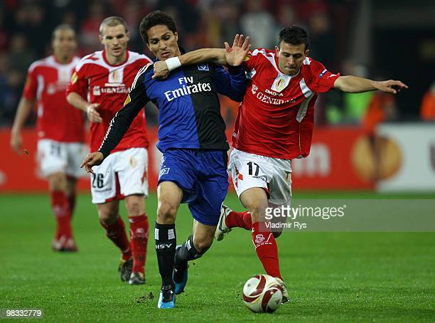 Paolo Guerrero of Hamburg and Marcos Camozzato of Liege battle for the ball during the UEFA Europa League quarter final second leg match between...